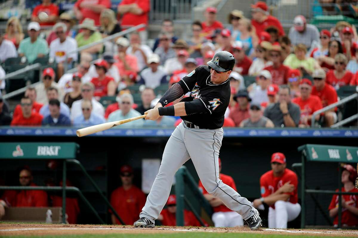 Miami Marlins' Justin Bour bats during the first inning of an exhibition spring training baseball game against the St. Louis Cardinals Thursday, March 3, 2016, in Jupiter, Fla. (AP Photo/Jeff Roberson)