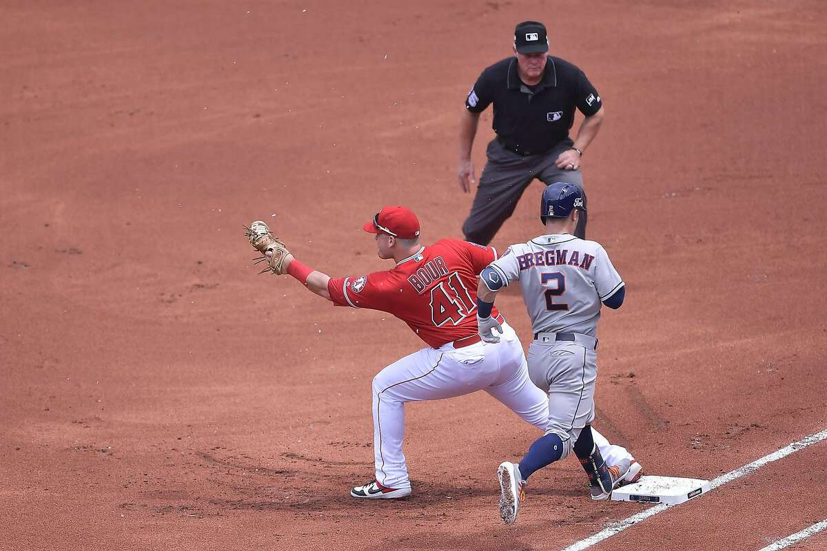 MONTERREY, MEXICO - MAY 05: Alex Bregman #2 of the Houston Astros is outed on first base by Justin Bour #41 of Los Angeles Angels on the first inning of the Houston Astros vs Los Angeles Angels of Anaheim match as part of the Mexico Series at Estadio de Beisbol Monterrey on May 05, 2019 in Monterrey, Nuevo Leon. (Photo by Azael Rodriguez/Getty Images)