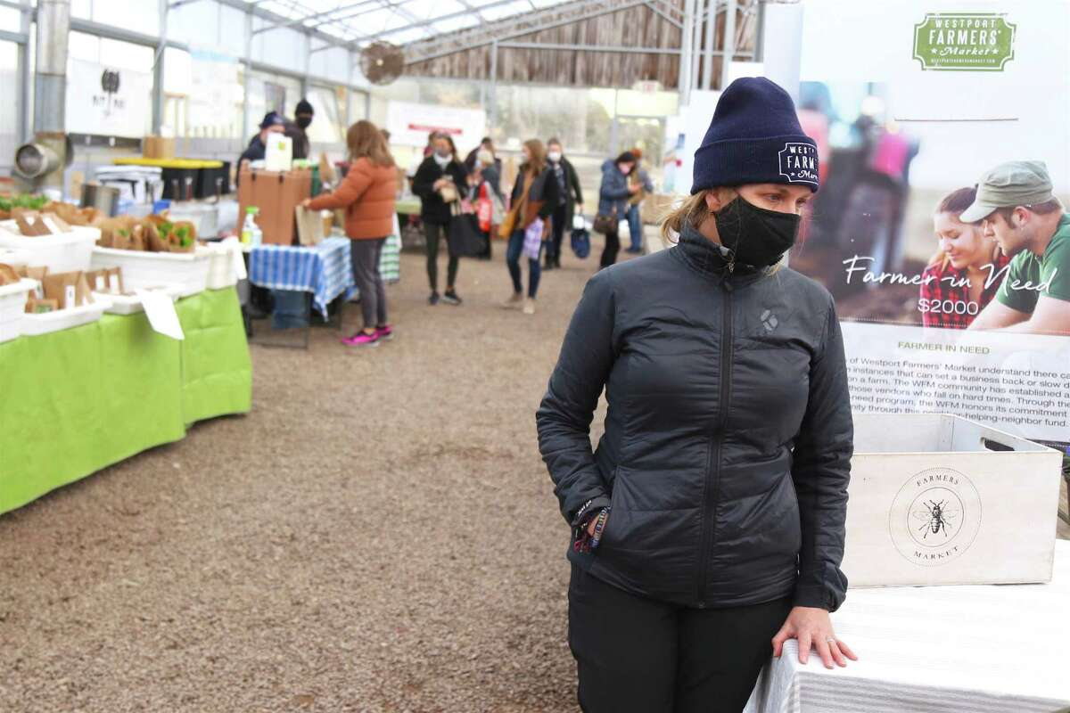 Lori Cochran-Dougall, the Westport Farmers' Market executive director, stn.ands in the marlet on March 4, 2021 in Westport, Con