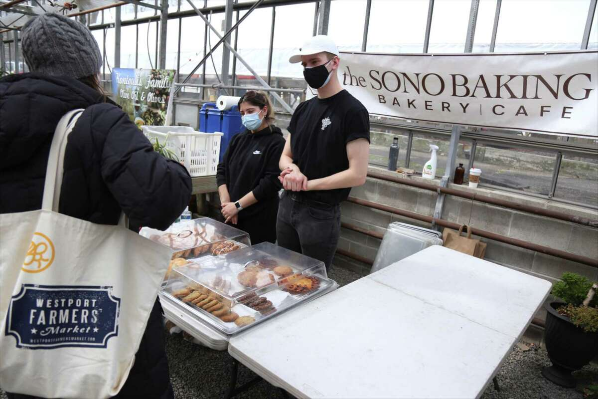 The SoNo Bakery Company, one of the original vendors, speaks with a customer at the Westport Farmers' Market on March 4, 2021 in Westport Conn.