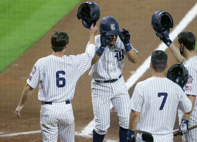 Rice center fielder Guy Garibay (2) celebrates with teammates after hitting a two-RBI home run against Sam Houston State during the fourth inning of the Shriner's Hospitals for Children College Classic at Minute Maid Park Friday, March 5, 2021, in Houston. Photo: Godofredo A. Vásquez, Staff Photographer / © 2021 Houston Chronicle