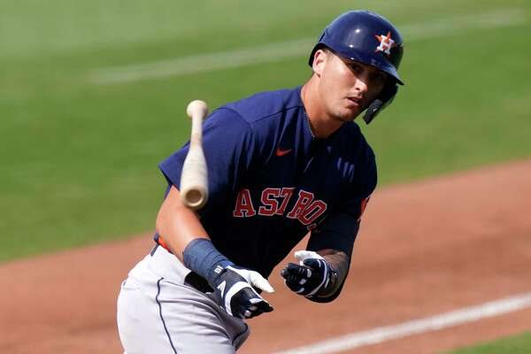 Houston Astros' Korey Lee tosses his bat as he draws a walk in the sixth inning of a spring training baseball game against the Miami Marlins, Friday, March 5, 2021, in Jupiter, Fla. (AP Photo/Lynne Sladky)