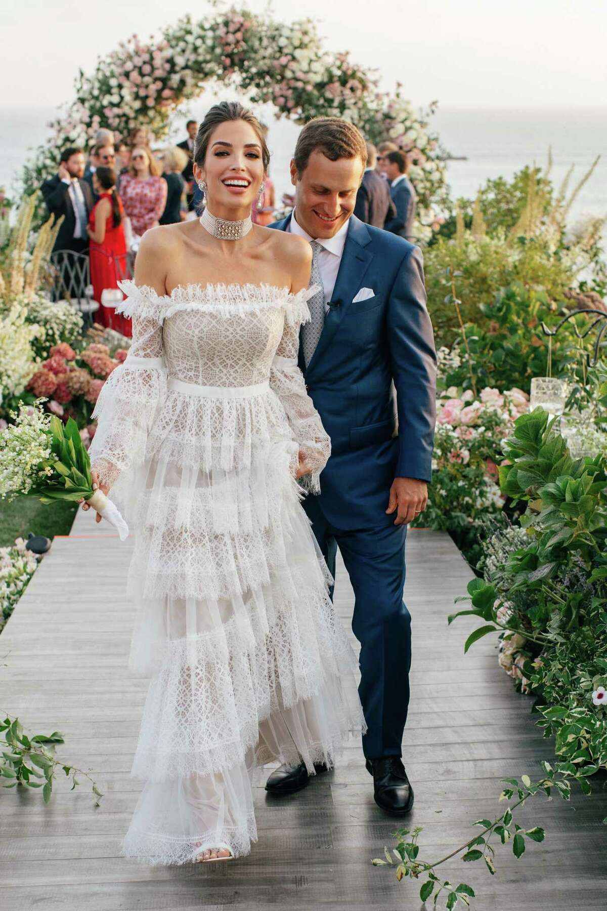 Lily Morris and Johnathan Schnitzer tie the knot at the bride's family home in San Clemente, Calif.
