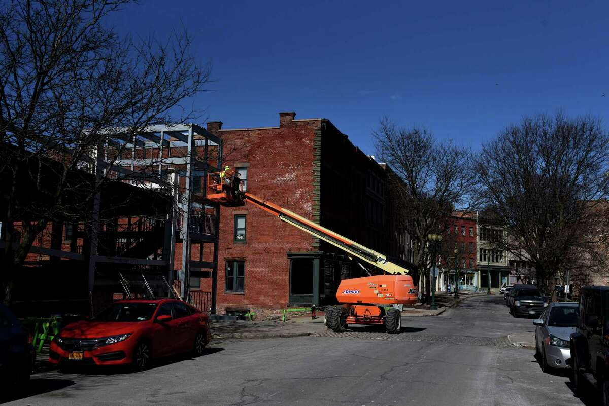A new stair tower for the State Street Garage is welded together on Friday, March 5, 2021, at River and State streets in Troy, N.Y. This is the first step in repairing the aging facility. (Will Waldron/Times Union)