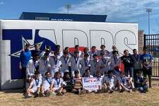 The Kelly Catholic boys soccer team poses for a picture after winning the TAPP Div. I state championship Friday in Round Rock.