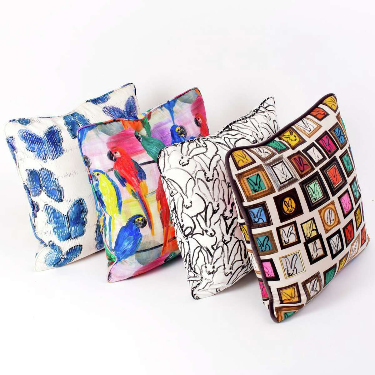 Artist Hunt Slonem has a new collection of home goods emblazoned with his cheerful drawings of bunnies and parrots. These cotton pillow covers are 22x22 and cost $325 each.