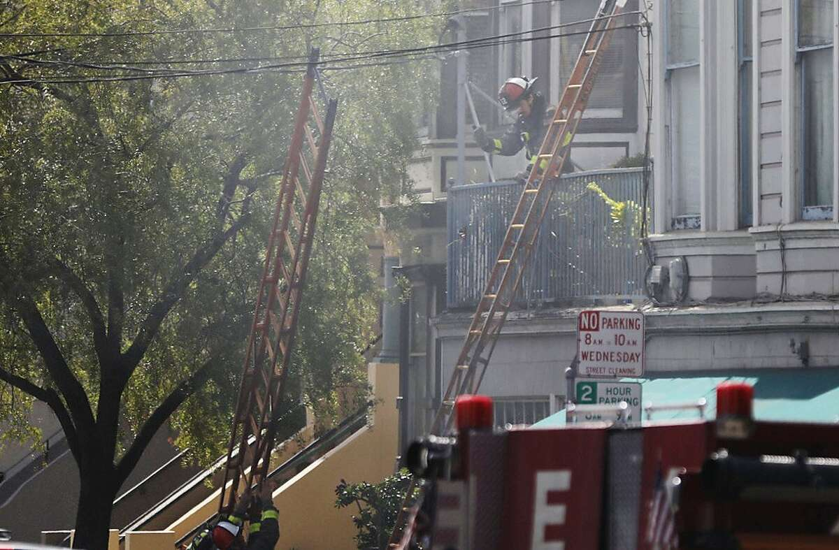 Firefighters battle a large house fire near the intersection of 18th and Eureka streets in the Castro district of San Francisco, Calif. Friday, March 5, 2021.