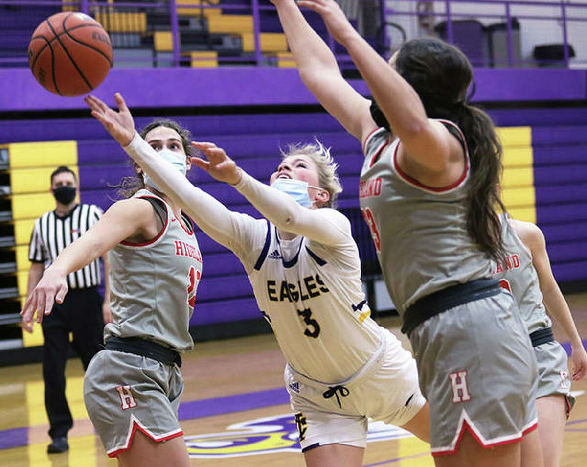 CM's Kelbie Zupan puts up a shot between Highland's Bella LaPorta (left) and Taylor Kesner (right) during the first half of their Mississippi Valley Conference girls basketball game Thursday night in Bethalto.