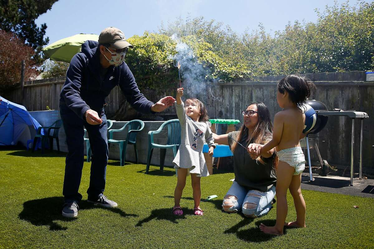 Filipina American nurse Juliet Palarca (second from right), who has faced racism during the pandemic, celebrates the Fourth of July in S.F. with father Cesar Palarca, daughter Tala Tito, and son TamatiTito.