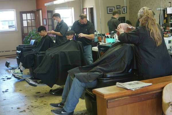 The chairs are frequently filled at Brown's Barbershop. (Pioneer photo/Joe Judd)