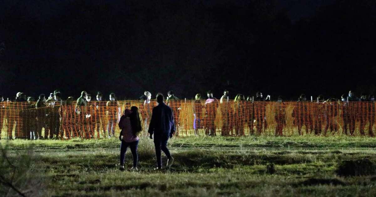 Migrants arrive at a U.S. Border Patrol processing area under the Anzalduas International Bridge in Hialdalgo County, Texas on Feb. 24.
