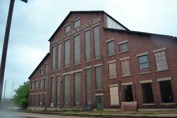 Developers plan to turn theIron Works property into a mixed use building with a hotel, cottages, amphitheater, townhouses, indoor market, retail outlets and medical marijuana grow facility. (File photo)