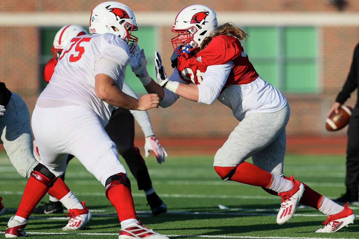 UIW defensive end Chance Main, right, applies pressure during a morning practice at Gayle and Tom Benson Stadium on Tuesday, Feb. 23, 2021. UIW plays its first game of the spring Southland Conference season Saturday at McNeese State.