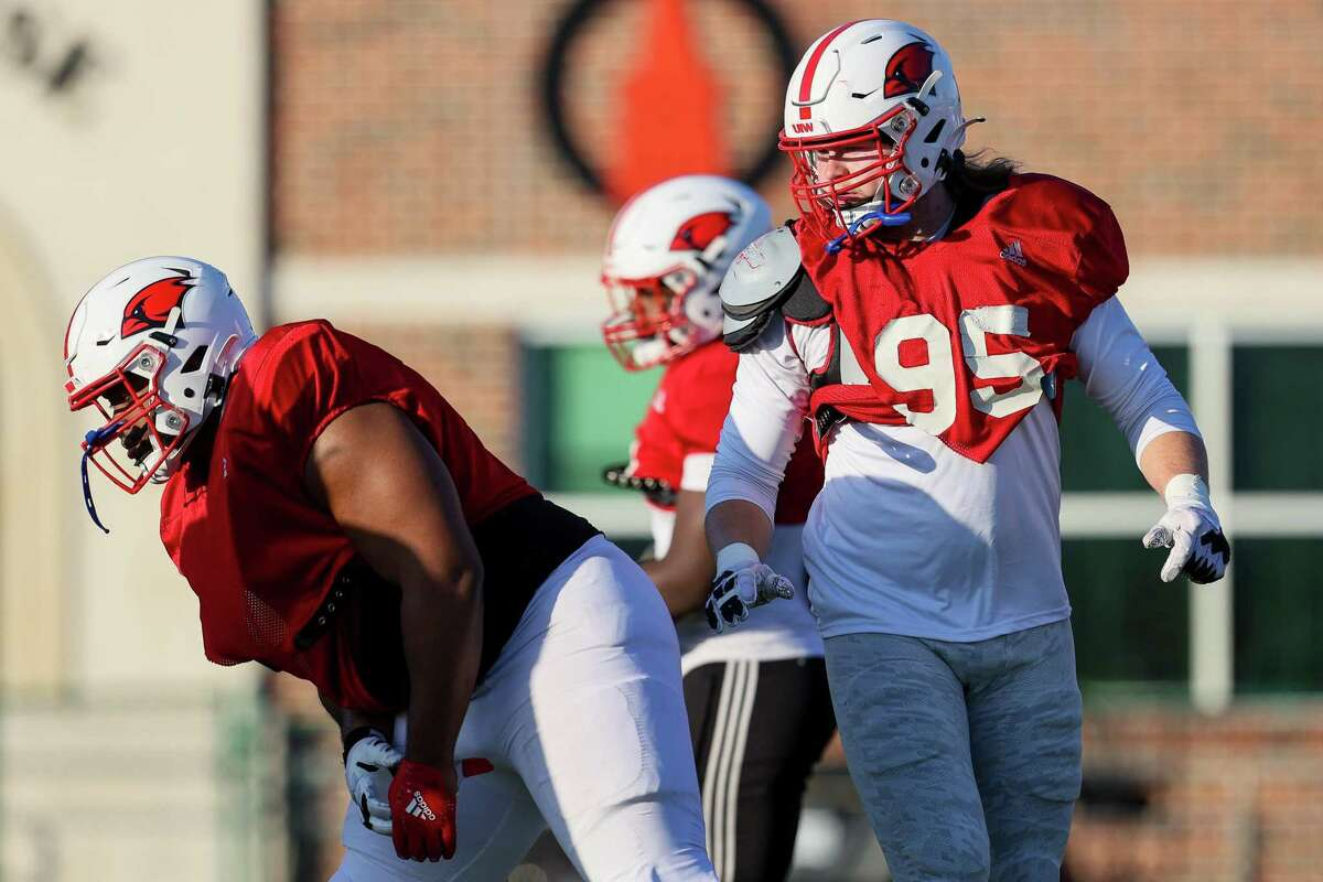 UIW defensive end Chance Main, right, during a morning practice at Gayle and Tom Benson Stadium on Tuesday, Feb. 23, 2021. UIW plays its first game of the spring Southland Conference season Saturday at McNeese State.