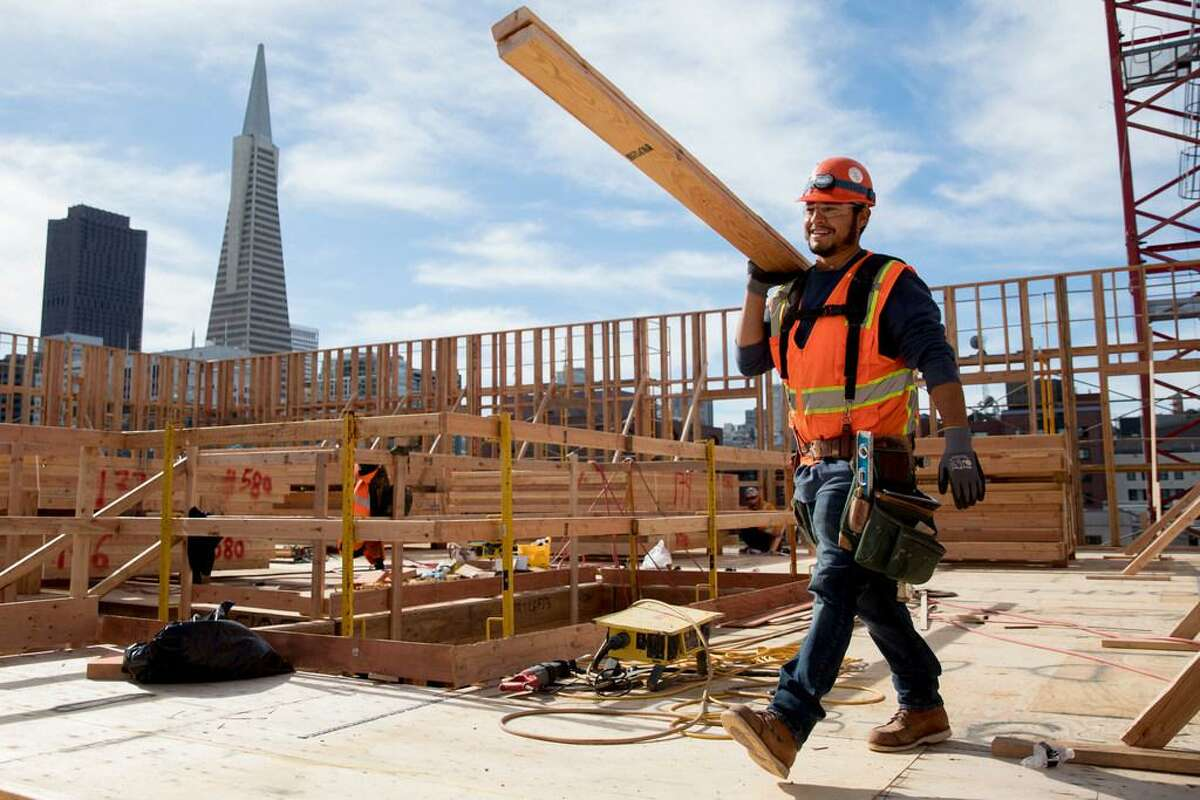 Workers continue construction on two affordable housing developments, one for seniors and one for multi-family use, along the Embarcadero near Broadway in San Francisco, Calif. Tuesday, February 4, 2020. San Francisco Mayor London Breed is planning to spearhead a signature-gathering effort to put a measure on the November 2020 ballot that will make 100% affordable housing developments easier to build.