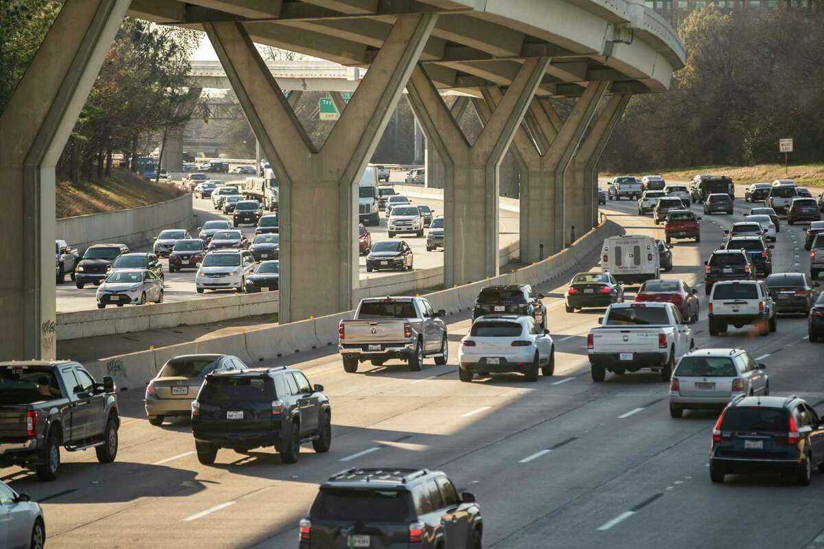 Traffic travels near downtown Houston at Houston Avenue on Interstate 10 on Wednesday, March 3, 2021.