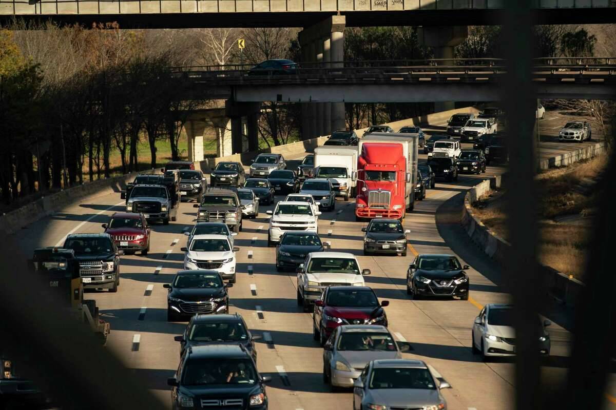 Traffic travels westbound away from downtown Houston near Houston Avenue on March 3, 2021, in Houston. Officials are considering how to increase capacity on I-10 within Loop 610, including possibly adding managed lanes from the West Loop to downtown Houston.
