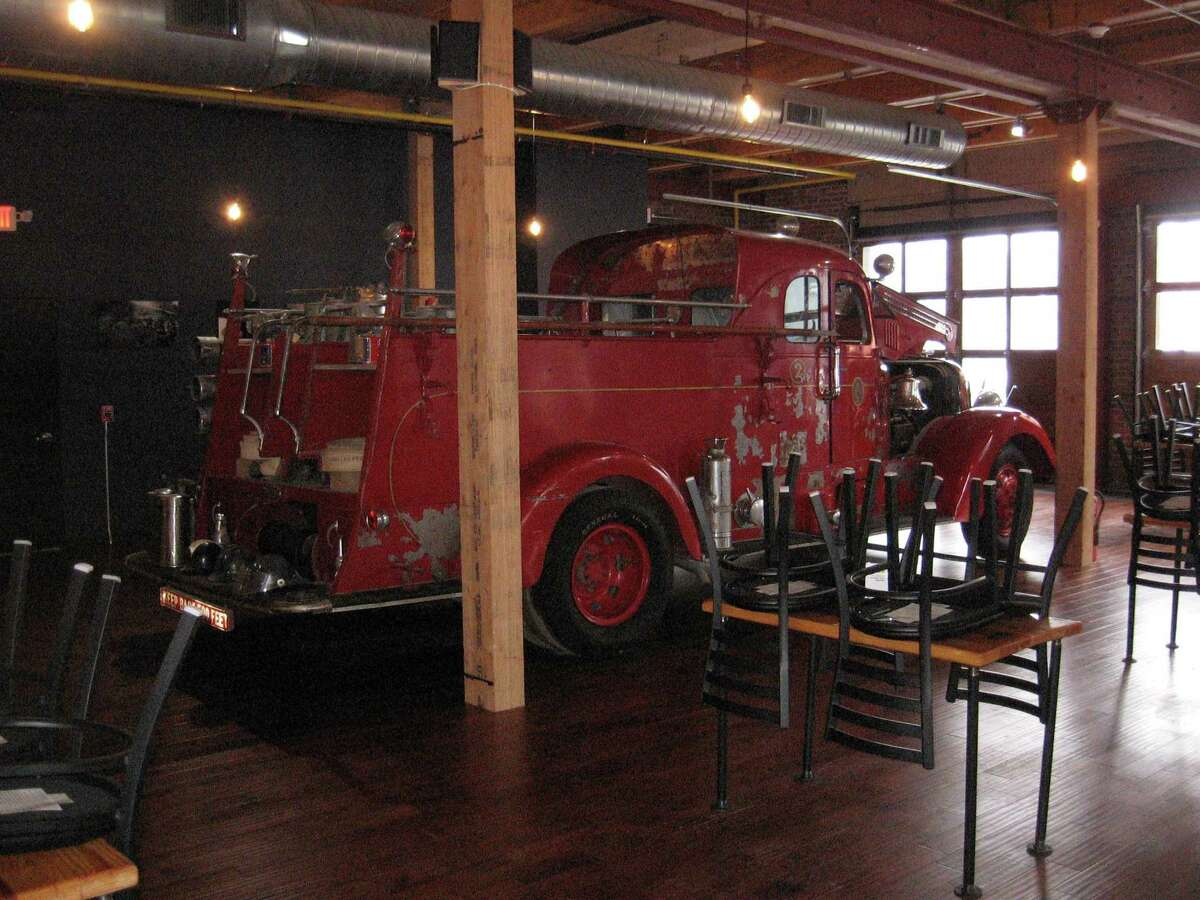 Bad Dog Brewing Co. opened in January on Water Street, Torrington. Here, a vintage fire truck stands in the pub, a remaining artifact that was intended to be used when the firehouse was to become a museum.