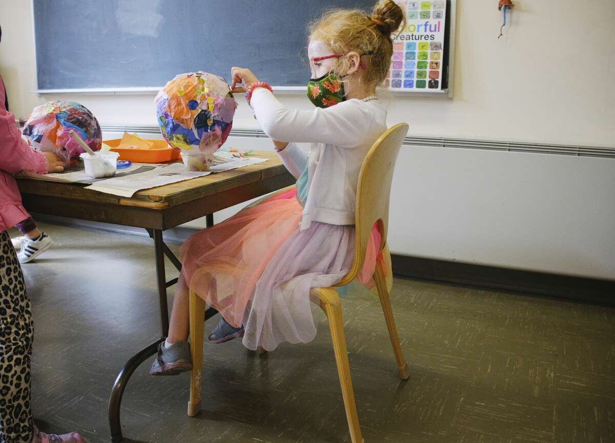 Castle Island Bilingual Montessori school student Mia Finlan, 5, glues tissue paper to her lantern in the art studio on Thursday, Sept. 17, 2020, in Albany, N.Y. The American Rescue Plan, set to pass Congress March 9, 2021, will means billions for schools. But they're still worried it could mean less support in the years to come. (Paul Buckowski/Times Union)