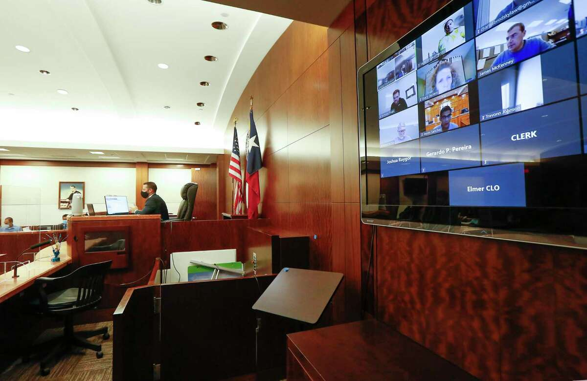 Judge Josh Hill uses Zoom conferencing to conduct courtroom hearings in the Harris County Criminal Justice Center 232nd Criminal Court Wednesday, Dec. 16, 2020, in Houston.