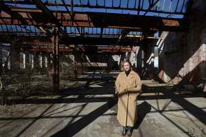 First Selectwoman Julia Pemberton stands in one of the buildings on the old Gilbert and Bennett Wire Mill property in Georgetown. The town spent years in a lengthy legal battle over the millions in unpaid taxes and lack of site development but regained ownership in February when the title transferred to the town. Redding, Conn, Friday, March 5, 2021.