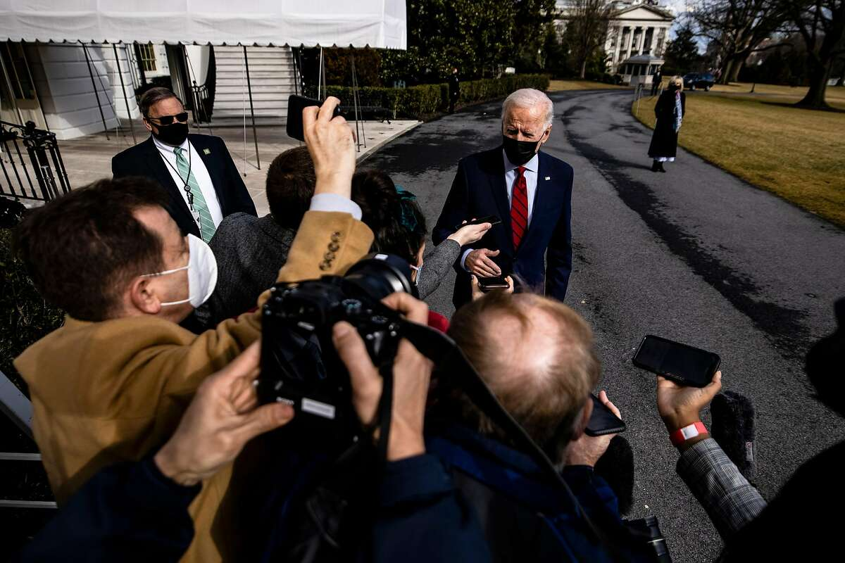 President Biden speaks with reporters on the South Lawn of the White House last month.