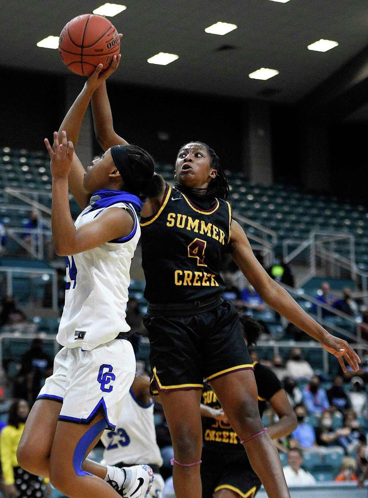 Summer Creek forward Kaitlyn Duhon (4) blocks the shot of Cypress Creek guard Krishawn Lee during the first half of a 6A Region III semifinal high school basketball playoff game, Friday, Feb. 26, 2021, in Katy, TX.