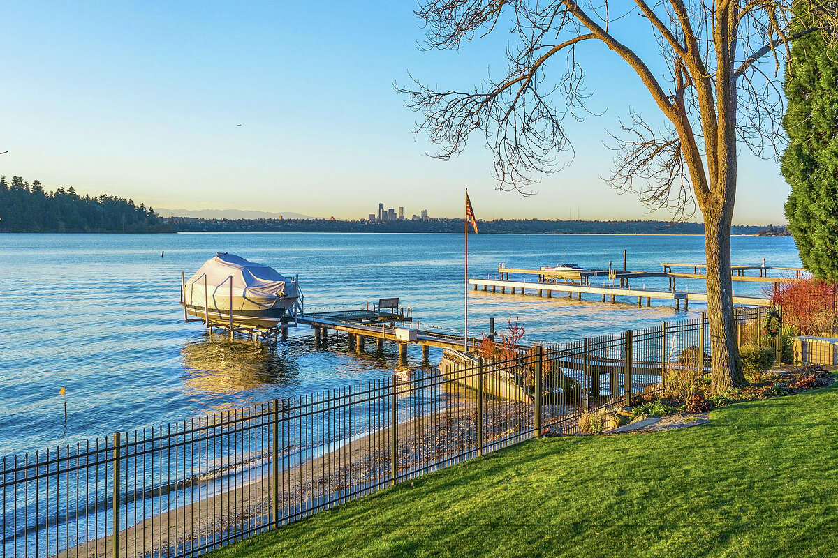 The property includes a private beach, waterfront and boat dock.