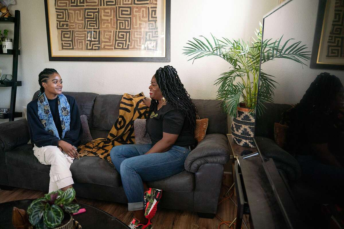 Janelle Goolsby (left) talks with her aunt, Natalie Goolsby, inside of her home in Oakland, Calif., on Friday, March 5, 2021. Janelle rents the home from her aunt, Natalie, while she attends college for fashion design and builds her career.