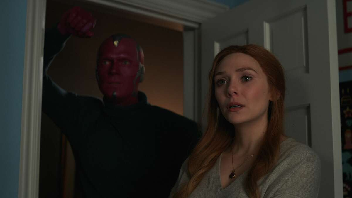 """Elizabeth Olsen as Wanda Maximoff/Scarlet Witch and Paul Bettany as Vision in """"WandaVision."""""""