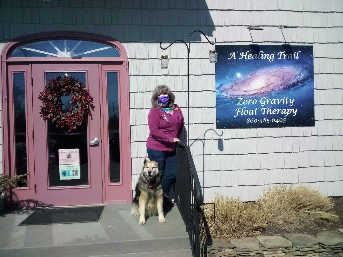 Franci Knight, owner of A Healing Trail Wellness Center in Harwinton, with her dog Venus.