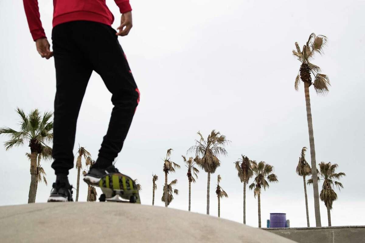 Khasier Watt, 15, skateboards at the Johnny Romano Skateboard Park, Friday, March 5, 2021, in Galveston.