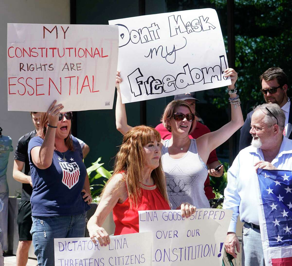 Protesters gather outside Harris County offices last April for a rally by Republican activist Steven Hotze against the mask mandate.