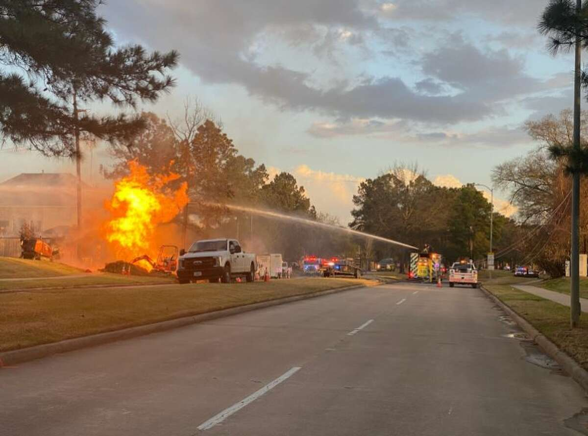 Firefighters are working to extinguish a suspected natural gas line fire in Klein.