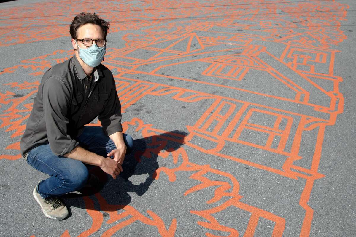Street artist Amos Goldbaum just completed a mural on a block of a slow street at Sanchez and 24th streets in San Francisco on March 5, 2021.