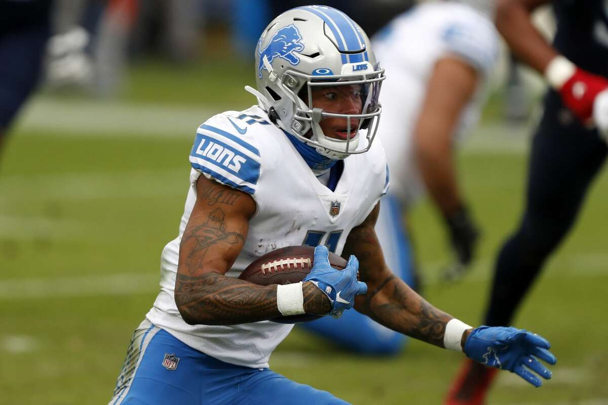 NASHVILLE, TENNESSEE - DECEMBER 20: Wide receiver Marvin Jones #11 of the Detroit Lions carries the football against the defense of the Tennessee Titans during the second quarter of the game at Nissan Stadium on December 20, 2020 in Nashville, Tennessee. (Photo by Wesley Hitt/Getty Images)