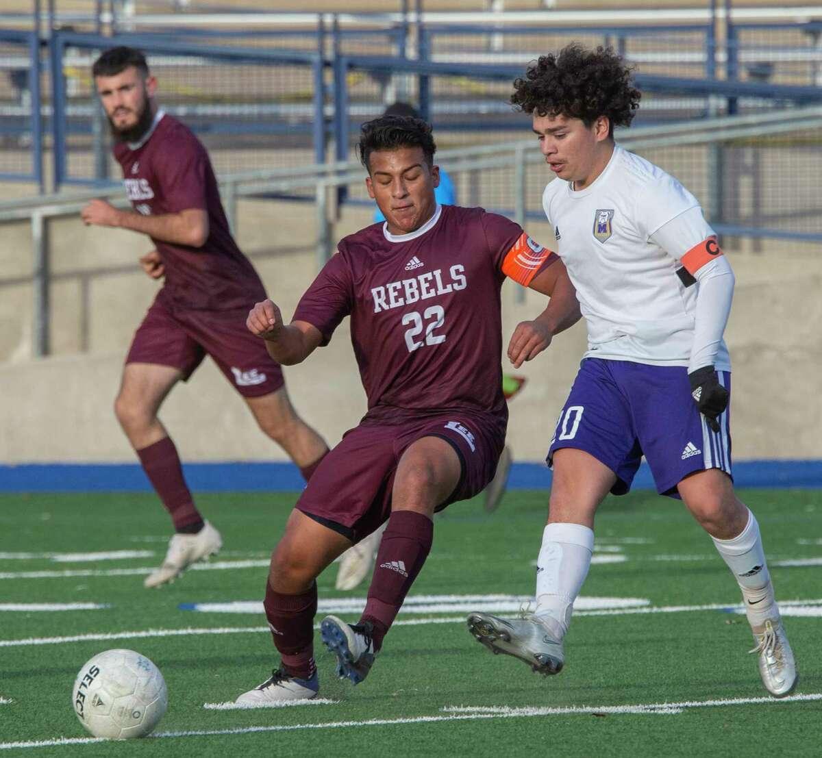 Lee High's Jacob Maltos and Midland High's Israel Ramirez battle for the ball 03/05/2021 at Grande Communications Stadium. Tim Fischer/Reporter-Telegram