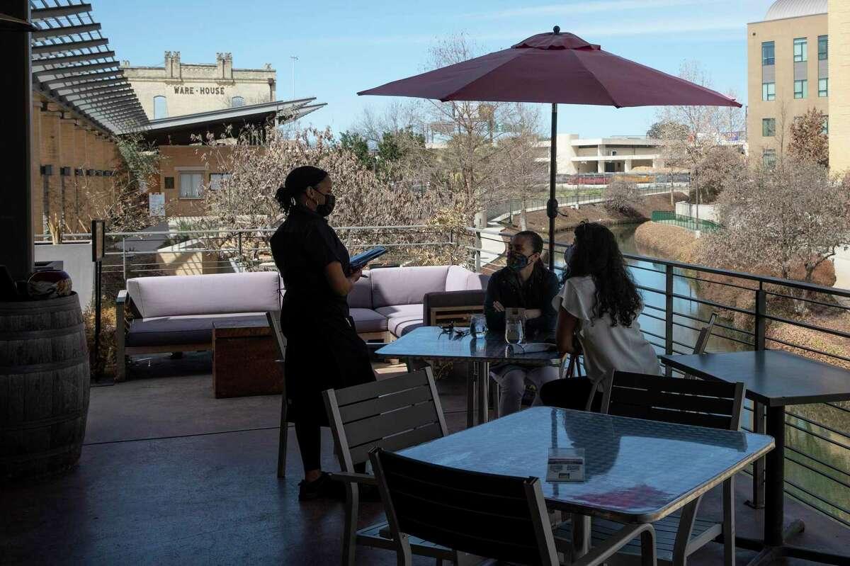 Gina Ortiz Jones and Ana Martinez Charmorro enjoy lunch at Tre Trattoria.
