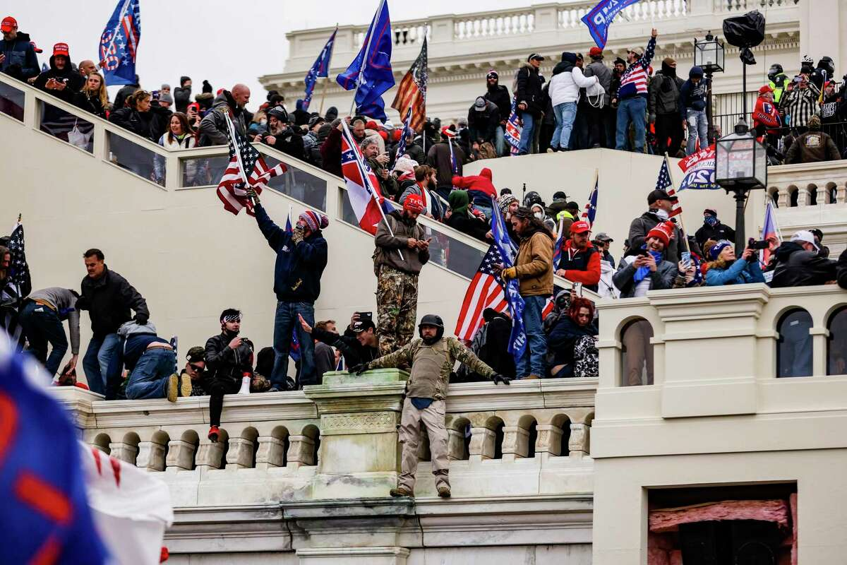 Donald Trump supporters storm the U.S. Capitol following a rally with the president on Jan. 6, 2021, in Washington, D.C.