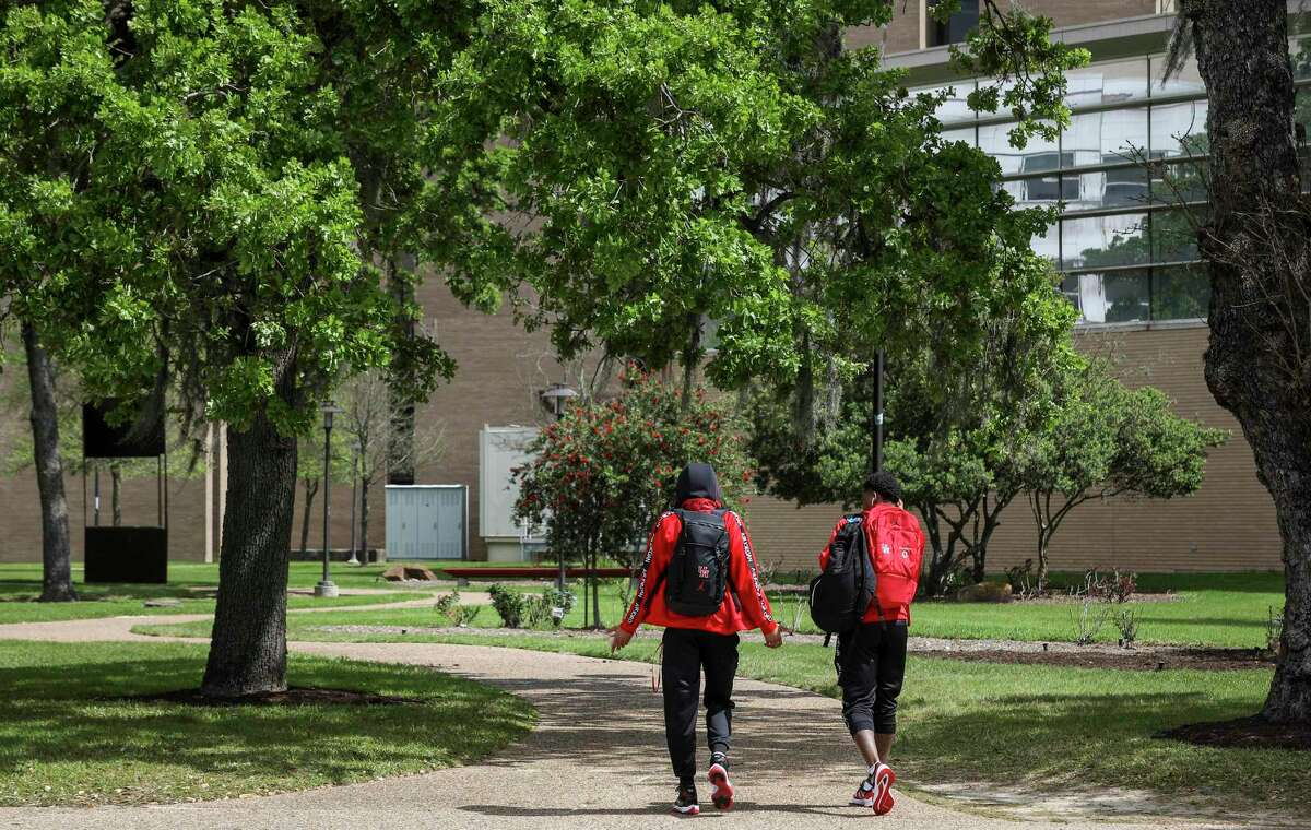 Caleb Mills and Marcus Sasser walk through campus after returning to Houston when the AAC tournament was canceled.