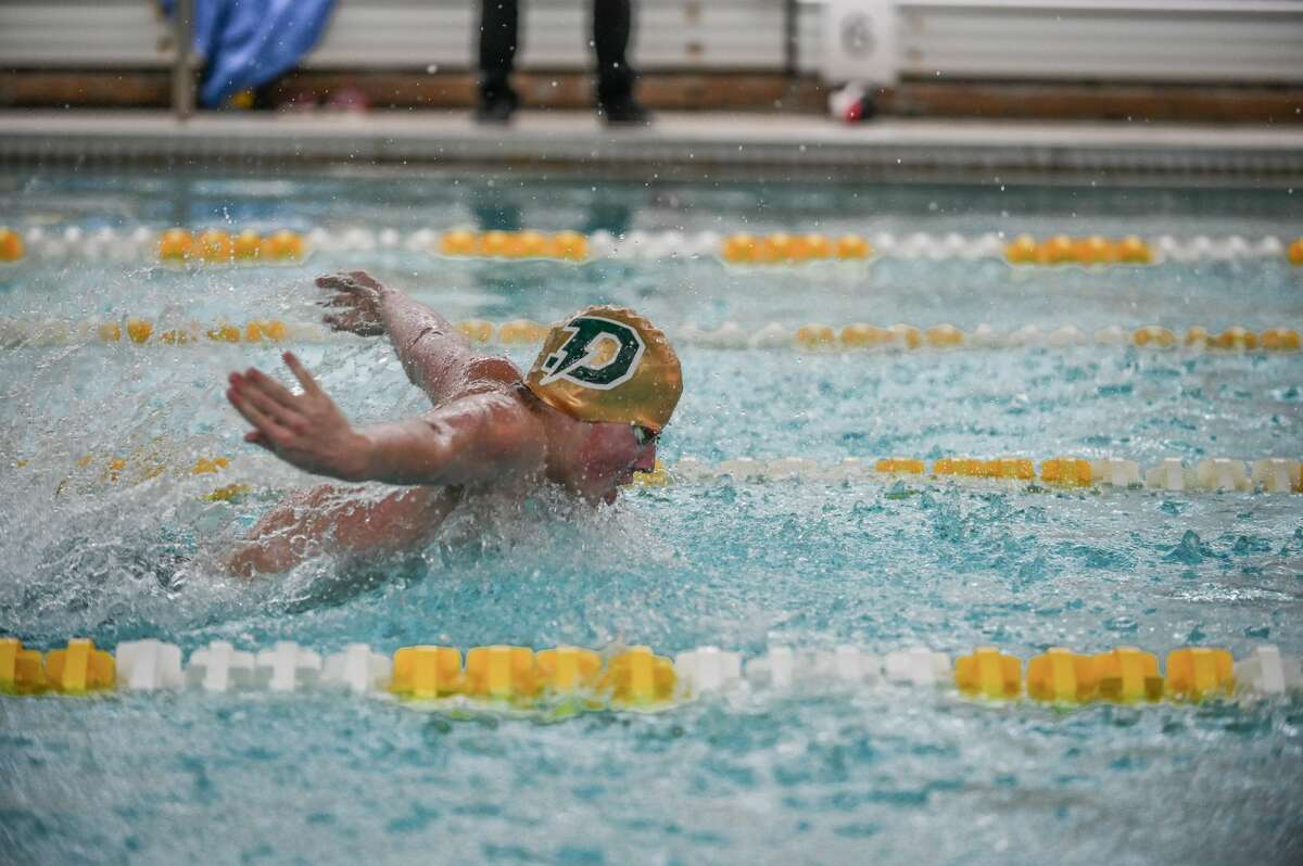A Dow High swimmer competes during a swim meet at Dow High School on March, 5th 2021. (Adam Ferman/for the Daily News)