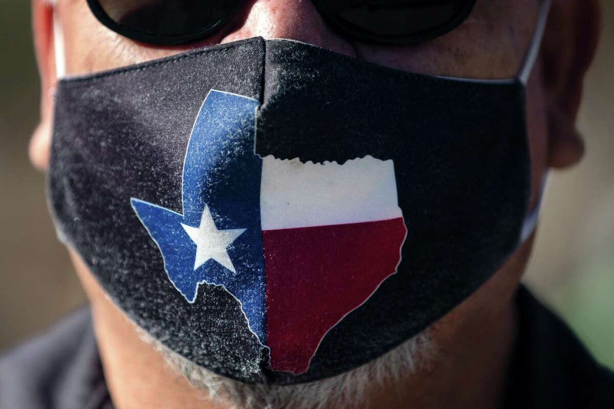 San Jose Hotel engineering manager Rocky Ontiveros, 60, wears a Texas mask on March 3, 2021, in Austin, Texas. Gov. Greg Abbott announced a new executive order that will end the statewide mask mandate and allow businesses to reopen at 100% capacity on March 10, 2021. (Montinique Monroe/Getty Images/TNS)