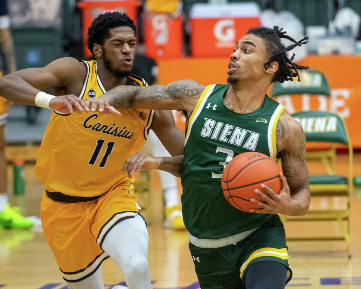 Siena College senior Manny Camper goes up strong against Canisius College sophomore Armon Harried during a Metro Atlantic Athletic Conference game at the UHY Center on the Siena College campus in Loudonville, NY, on Friday, March 5, 2021 (Jim Franco/special to the Times Union.)