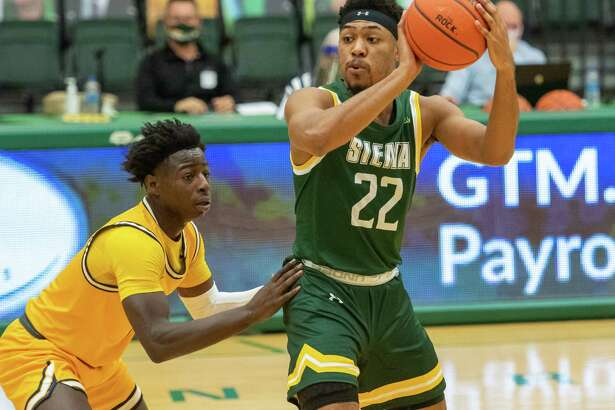 Siena College junior Jalen Pickett works in front of Canisius College senior Majesty Brandon during a Metro Atlantic Athletic Conference game at the UHY Center on the Siena College campus in Loudonville, NY, on Friday, March 5, 2021 (Jim Franco/special to the Times Union.)