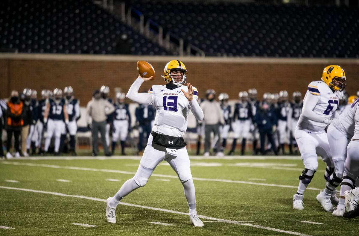 Redshirt sophomore quarterback Jeff Undercuffler attempt a pass against New Hampshire in a Colonial Athletic Association football game Friday, March 6, 2021, in Durham, N.H. (China Wong/UNH athletics)