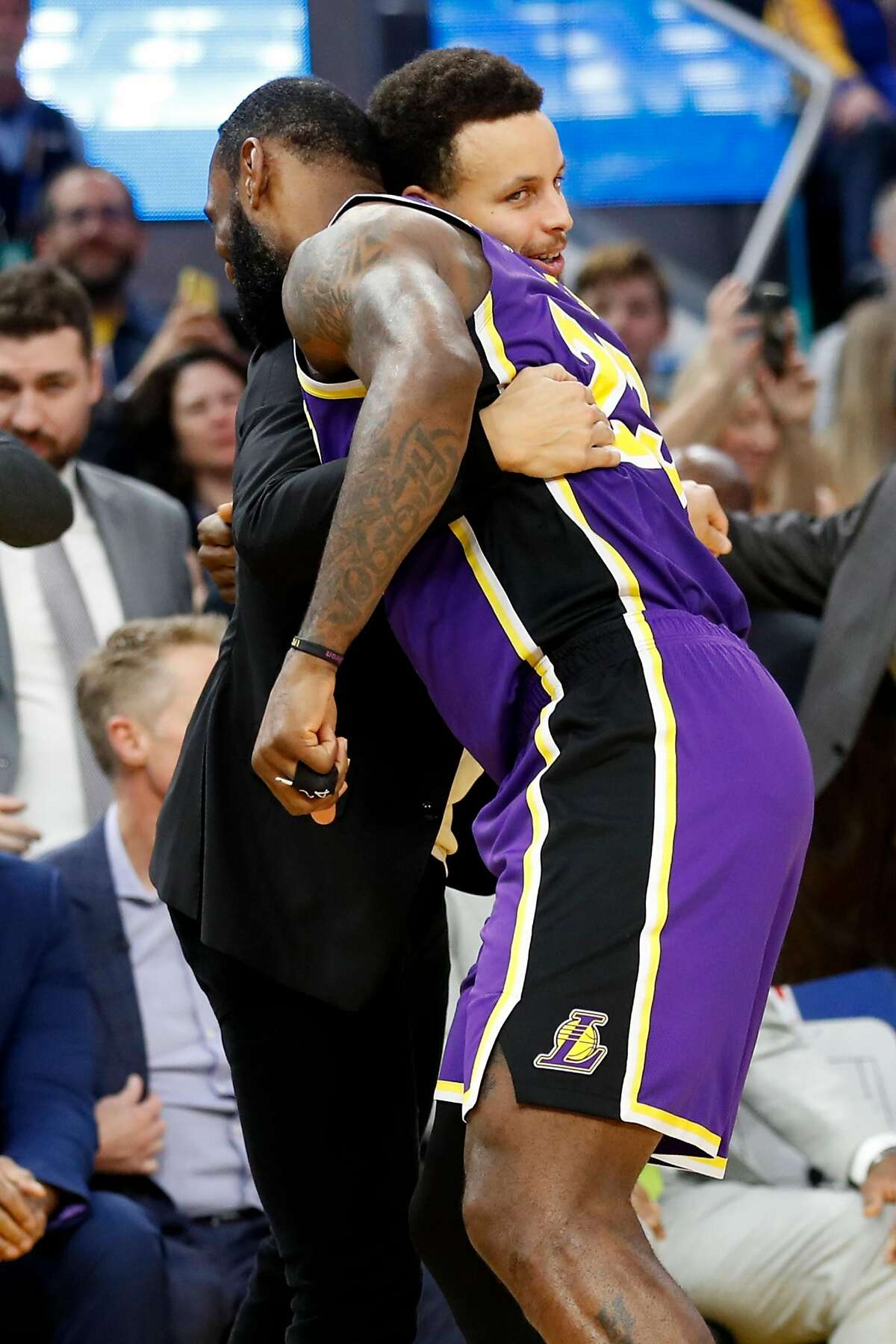 Golden State Warriors' Stephen Curry greets Los Angeles Lakers' LeBron James before NBA game at Chase Center in San Francisco, Calif., on Saturday, February 8, 2020.