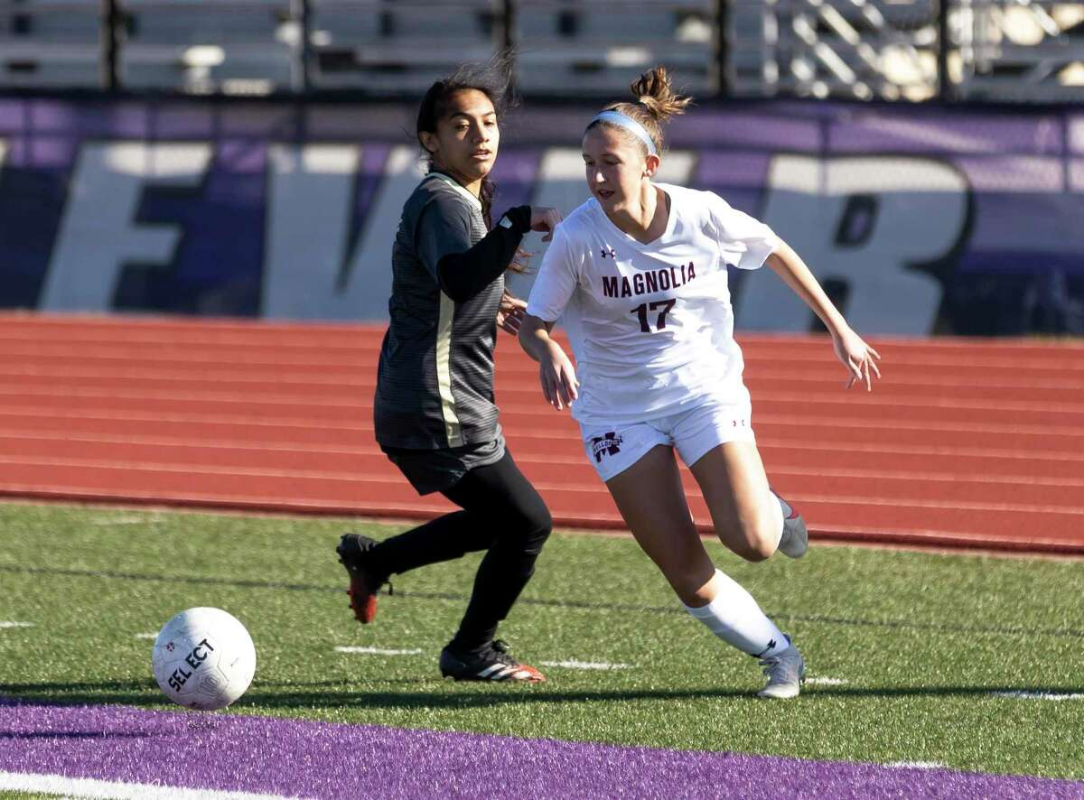 FILE - Magnolia defensive midfielder Sarah Giannotti (17) steals control of the ball from Conroe Alexis Zarate (7) in the first period of non-district girls soccer match at Berton A. Yates Stadium, Friday, Jan. 15, 2021, in Willis.