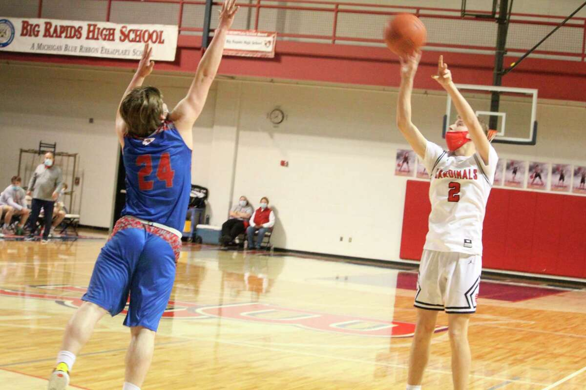 Big Rapids' Dawson Dunn, who had five triples and 19 points on Friday, shoots over Chippewa Hills' Levi Rogers (24). (Pioneer photo/John Raffel)