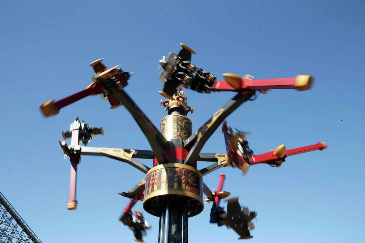 Dare Devil Dive Flying Machines is shown locked up in a video with more than 3 million times on the platform. The steampunk-themed ride sends riders through loops and dives 48 feet in the air. Some guests were left in an upside down position when the ride stopped.