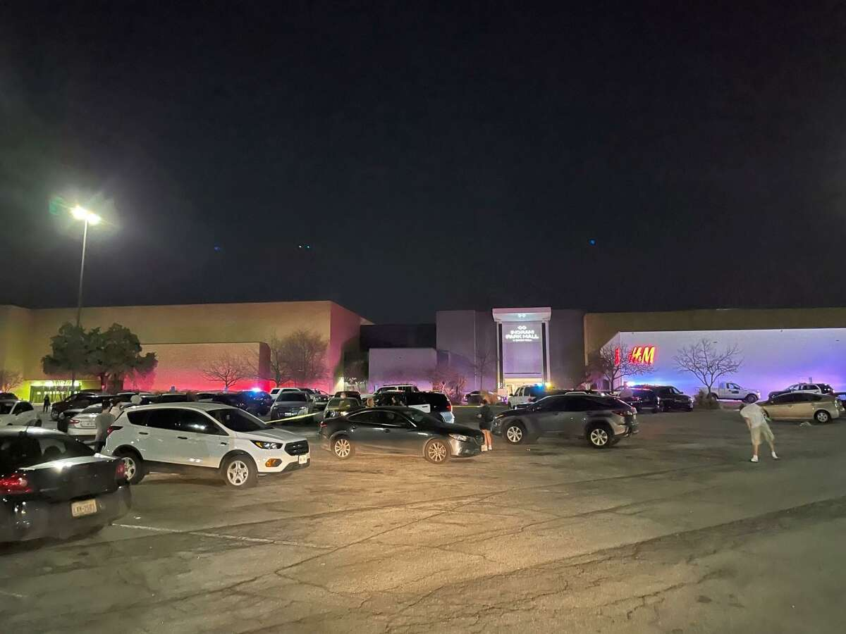 Police investigate a shootout outside Ingram Park Mall on Friday, March 5, 2021.